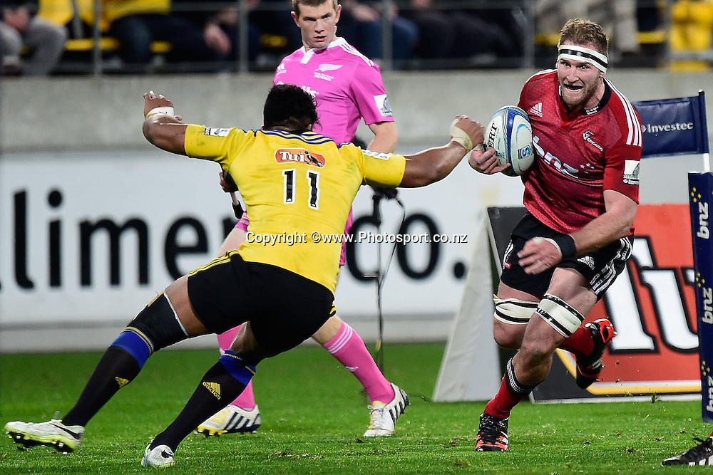 Kieran Reid (R of the Crusaders faces Julian Savea of the Hurricanes during the Super Rugby - Hurricanes v  Crusaders rugby match at the Westpac Stadium in Wellington, New Zealand on the 28th of June 2014. Photo: Marty Melville/www.Photosport.co.nz