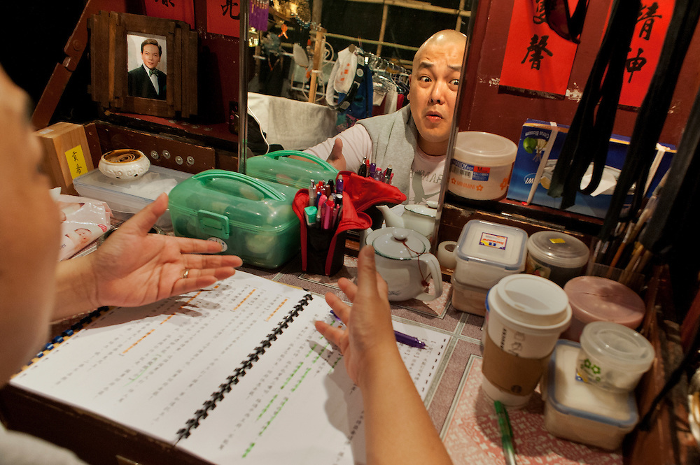 "Actor LEUNG Wai Hong in his dressing room rehearsals before the Opera ""Execution of the Duke's Second Brother"" performed at the West Kowloon Bamboo theatre."