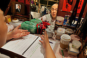 """Actor LEUNG Wai Hong in his dressing room rehearsals before the Opera """"Execution of the Duke's Second Brother"""" performed at the West Kowloon Bamboo theatre."""
