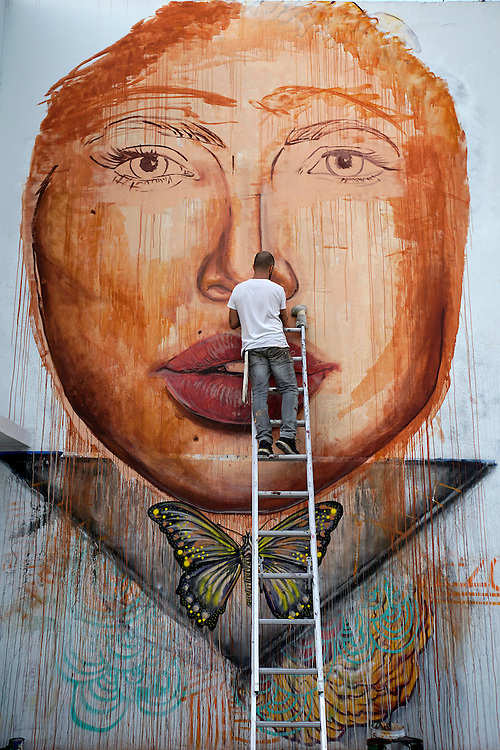 MIAMI BEACH, FLORIDA, NOVEMBER 2, 2015<br /> Mexican artist Leonardo Tezcucano works on a wall in Wynwood a day before  the official opening of Art Basel 2015. (Photo by Angel Valentin/Freelance)