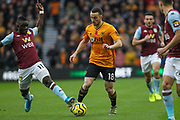 Diogo Jota of Wolverhampton Wanderers is tackled by Marvelous Nakamba of Aston Villa during the Premier League match between Wolverhampton Wanderers and Aston Villa at Molineux, Wolverhampton, England on 10 November 2019.