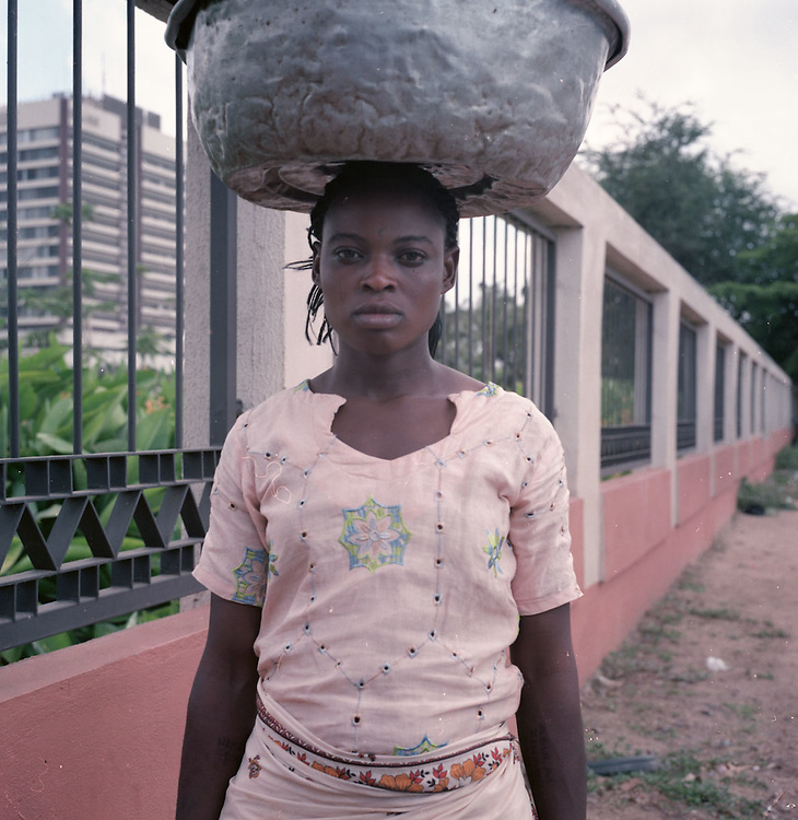 Kayayo girls on the side of a busy street in Accra, Ghana 2011
