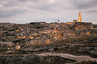 """MATERA, ITALY -6 OCTOBER 2019: A view of Matera, the set for Milo Rau's """"The New Gospel"""" (2019),  Pier Paolo Pasolni's """"The Gospel According to Matthew"""" (1964) and Mel Gibson's """"The Passion of the Christ (2004), is seen here during the production of """"The New Gospel"""", a film by Swiss theatre director Milo Rau, in Matera, Italy, on October 6th 2019.<br /> <br /> Theatre Director Milo Rau filmed the Passion of the Christ  under the title """"The New Gospel"""" with a cast of refugees, activists and former actors from Pasolini and Mel Gibson's films.<br /> <br /> The role of Jesus is performed by Yvan Sagnet, a Political activist born in Cameroon and who worked on a tomato farm when in 2011 he revolted against the system of exploitation and led the first farm workers' strike in southern Italy. In a series of public shoots in the European Capital of Culture Matera, Jesus will proclaimed the Word of God, was crucified (October 6th 2019) and finally rose from the dead in Rome, the capital of Catholic Christianity and seat of one of the most xenophobic governments in Europe (October 10th 2019).<br />  <br /> Parallel to the film, the humanistic message of the New Testament was transformed into the present: at the beginning of September, the campaign """"Rivolta della Dignità"""" (Revolt of Dignity), which demanded fair working and living conditions     for refugees, global freedom of travel and civil rights for all, started with a march from the southern Italian refugee camps. """"It's about putting Jesus on his feet,"""" director Milo Rau said. Led by Jesus actor Yvan Sagnet, the campaign fights for the rights of migrants who came to Europe via the Mediterranean to be enslaved by the Mafia in the tomato fields of southern Italy and to live in ghettos under inhumane conditions. The campaign and the film thus create a """"New Gospel"""" for the 21st century, a manifesto of solidarity with the poorest, a revolt for a more just and humane world."""