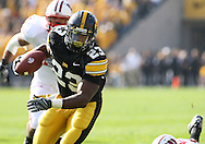 18 OCTOBER 2008: Iowa running back Shonn Greene (23) runs 12 yards for a touchdown in the first half of an NCAA college football game against Wisconsin, at Kinnick Stadium in Iowa City, Iowa on Saturday Oct. 18, 2008. Iowa won 38-16.