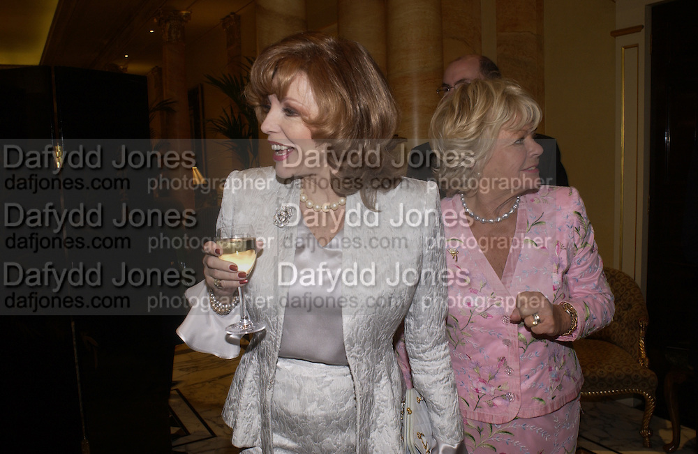 Joan Collins and Judith Chalmers, Judith Chalmers and The Lady Taverners pay tribute to Joan Collins at a  lunch  at The Dorchester. 14th May 2004. ONE TIME USE ONLY - DO NOT ARCHIVE  © Copyright Photograph by Dafydd Jones 66 Stockwell Park Rd. London SW9 0DA Tel 020 7733 0108 www.dafjones.com