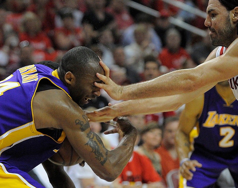 The Lakers' Kobe Bryant gets a face full of fingers from Houston's Luis Scola during the Lakers' 99-87 loss Sunday...///ADDITIONAL INFO:  lakers.0511.kjs5.jpg  ---  Photo by Kevin Sullivan, The Orange County Register --  ..The Los Angeles Lakers take on the Houston Rockets in Game 4 of the Western Conference semifinals Sunday May 10, 2009 at the Toyota Center in Houston, Texas..