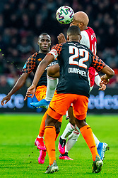 Ryan Babel #49 of Ajax, Bruma #7 of PSV Eindhoven, Denzel Dumfries #22 of PSV Eindhoven in action during the match between Ajax and PSV at Johan Cruyff Arena on February 02, 2020 in Amsterdam, Netherlands