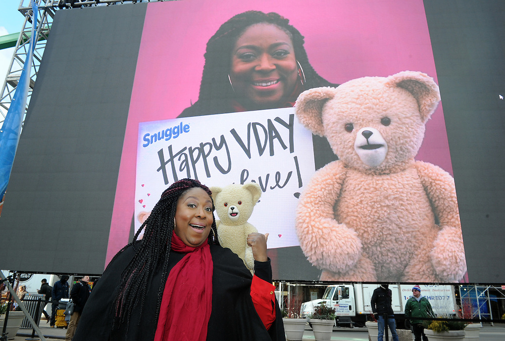 Comedian and TV host Loni Love poses with Snuggle Bear outside of the #BearYourHeart event to celebrate Valentine's Day and help people express their heartfelt emotions, Thursday, Feb. 11, 2016, in New York. (Diane Bondareff/AP Images for Snuggle)