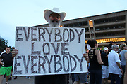 An anti white supremacy protestor shares a message of hope during the Anti Racism Rally in front of Dallas City Hall. Hundreds gatered to denounce white supremacy and hatred on Saturday August 19, 2017.