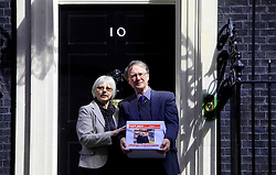 © Licensed to London News Pictures 24/04/2013.Bookshop owners Keith and Frances Smith hand in a petition of over 157,000 signatures to Downing Street, challenging Amazon over its reduced payment of UK corporate tax. .London, UK.Photo credit: Anna Branthwaite/LNP