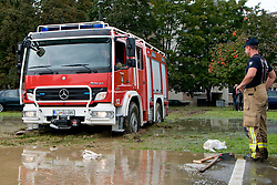 Fireman watches truck stuck in mud after heavy rain on September 19, 2010, in Ljubljana, Slovenia. (Photo by Matic Klansek Velej / Sportida)