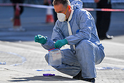 © Licensed to London News Pictures. 13/09/2018. London, UK. Forensic investigators at the scene of a double stabbing that happened in the early hours of the morning outside Shepherd's Bush tube station. A man in his early thirties was arrested on suspicion of two counts of grievous bodily harm, he remains in police custody. Photo credit: Guilhem Baker/LNP