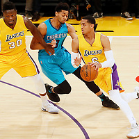 28 February 2017: Los Angeles Lakers guard Jordan Clarkson (6) drives past Charlotte Hornets guard Jeremy Lamb (3) on a screen set by Los Angeles Lakers forward Julius Randle (30) during the Charlotte Hornets 109-104 victory over the LA Lakers, at the Staples Center, Los Angeles, California, USA.