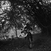 Steve Christiansen rides along the Ho Chi Minh Trail, Laos.