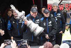 Emirates Team New Zealand's CEO Grant Dalton, centre, holds the Americas Cup during the victory parade in Dunedin, New Zealand, Thursday, July 13, 2017. Credit:SNPA / Adam Binns ** NO ARCHIVING**