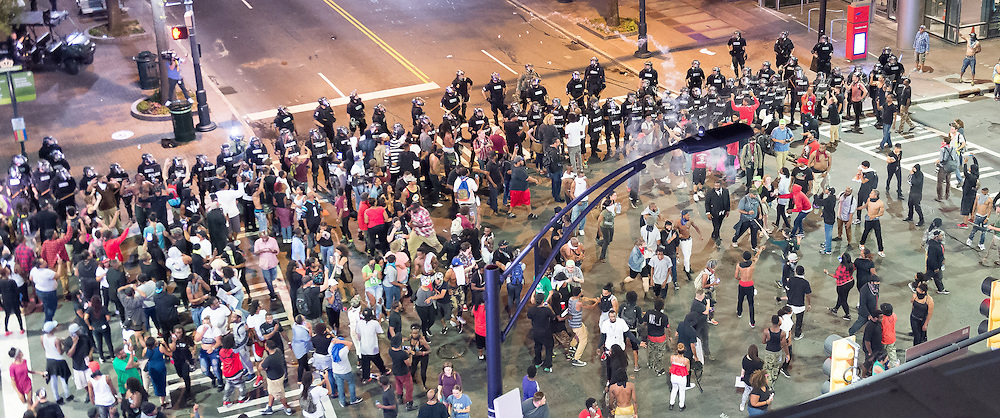 September 21, 2016 - Charlotte, North Carolina, United States of America - Sept. 21, 2016 - Charlotte, UNITED North CarolinaS - , Protestors confront police along Trade Street during a protest and eventual riot in Uptown Charlotte, North Carolina, The United States, Wednesday 21 September 2016. This is the second day of violence that erupted after a police officer's fatal shooting of an African-American man Tuesday afternoon. (Credit Image: © Sean Meyers via ZUMA Wire)