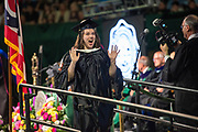 Claudia Coffey reacts after receiving her masters degree at graduate commencement ceremonies. Photo by Ben Siegel