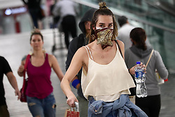 March 17, 2020, Mexico City, Mexico: A female passenger use a face mask and bandana at the International Airport of Mexico City before phase 1 of the coronavirus contingency is implemented to help stop the spread of the disease. (Credit Image: © Diego Sanchez/El Universal via ZUMA Wire)
