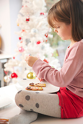 Young Girl Decorating Ginger bread man Biscuits