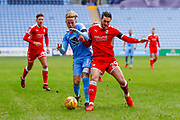 Coventry City forward Jordan Maguire-Drew (17), on loan from Brighton & Hove Albion,  battles with Swindon Town midfielder Oliver Banks (29), on loan from Oldham Athletic,  during the EFL Sky Bet League 2 match between Coventry City and Swindon Town at the Ricoh Arena, Coventry, England on 20 January 2018. Photo by Simon Davies.