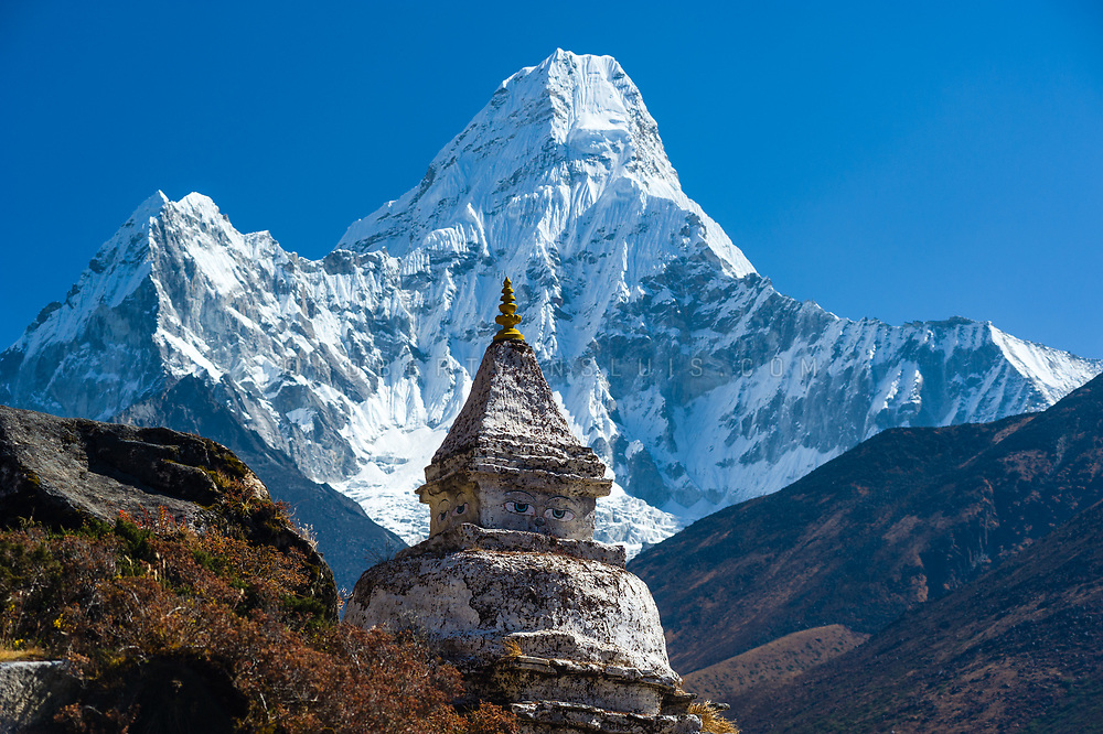 Buddhist stupa with Ama Dablam (6856 m) in the Nepal Himalaya. Photo © robertvansluis.com