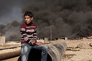 Iraq, Qayyara: On October 2016 a child is seen in Qayyara where IS fighters set on fire crude oil fields as they retreated. Alessio Romenzi