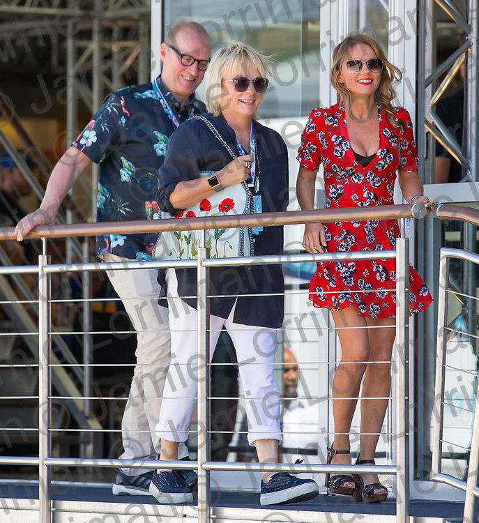 The 2018 Formula 1 F1 Rolex British grand prix, Silverstone, England. Sunday 8th July 2018.<br /> <br /> Pictured: Comedy couple Ade Edmondson and Jennifer Saunders with spice girl Geri Horner as they walk through the paddock ahead of the race at Silverstone.<br /> <br /> Jamie Lorriman<br /> mail@jamielorriman.co.uk<br /> www.jamielorriman.co.uk<br /> 07718 900288