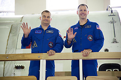 At the Gagarin Cosmonaut Training Center in Star City, Russia, Expedition 57 crewmembers Alexey Ovchinin of Roscosmos and Nick Hague of NASA wave to reporters Sept. 13 during the first day of their Soyuz qualification exams. They are scheduled to launch Oct. 11 from the Baikonur Cosmodrome in Kazakhstan on the Soyuz MS-10 spacecraft for a six month mission on the International Space Station.<br /> <br /> NASA/Elizabeth Weissinger