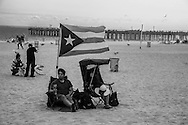 New York. Brooklyn. cuban party on  the boardwalk in Coney island beach  in summer . people swimming  United States / fete cubaine sur la promenade de Coney island en ete.  Brooklyn  New York - Etats Unis
