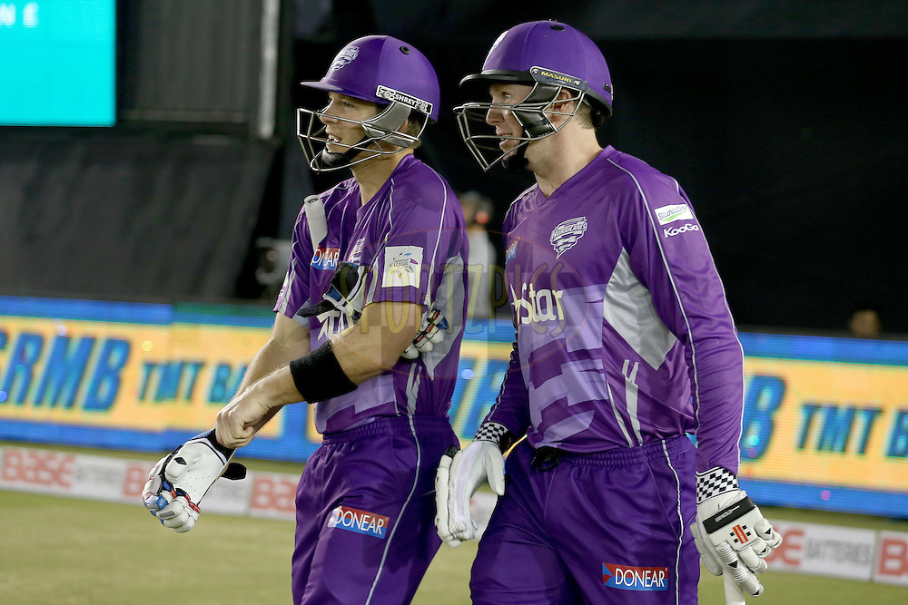 Opening batsmen Ben Dunk and Tim Paine walking out onto the field during match 2 of the Oppo Champions League Twenty20 between the Kings XI Punjab and the Hobart Hurricanes held at the Punjab Cricket Association Stadium, Mohali, India on the 18th September 2014. Photo by:  Jacques Rossouw / Sportzpics/ CLT20<br /> <br /> <br /> Image use is subject to the terms and conditions as laid out by the BCCI/ CLT20.  The terms and conditions can be downloaded here:<br /> <br /> http://sportzpics.photoshelter.com/gallery/CLT20-Image-Terms-and-Conditions-2014/G0000IfNJn535VPU/C0000QhhKadWcjYs