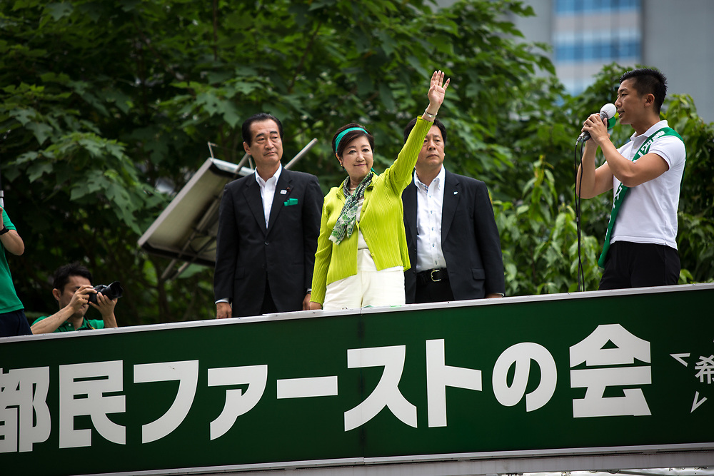 TOKYO, JAPAN - JULY 1: Tokyo Gov. Yuriko Koike, center, who also heads the Tokyo Citizens First party, waves her hands to voters from atop of a campaign van with party's members during election campaign for Tokyo Metropolitan Assembly on July 1, 2017 in Akihabara, Tokyo, Japan. (Photo: Richard Atrero de Guzman/NUR Photo)