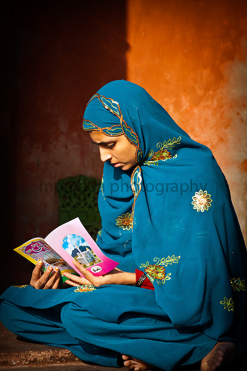 Muslim girl reading in Jama Masjid Mosque