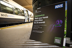 © Licensed to London News Pictures. 19/03/2020. London, UK. A poster providing public health information about the Coronavirus outbreak stacked up on the platform at Charing Cross Station in London. The government has announced a series of measures designed to slow the spread of the virus, which is now spreading more rapidly in the capital than in other parts of the country. Photo credit: Rob Pinney/LNP