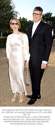Photographer SAM TAYLOR-WOOD and her husband JAY JOPLING, at a party in Berkshire on 27th June 2002.PBK 123