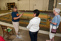 Christine Hadsel of Curtains Without Borders, Laconia Historical Society Director Brenda Kean and Dorothy Duffy view the Moulton Opera House Curtain on Wednesday afternoon.  (Karen Bobotas/for the Laconia Daily Sun)