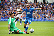 Peterborough United forward Jason Cummings (35) is fouled by Luton Town goalkeeper Marek Stech (1) for a penalty during the EFL Sky Bet League 1 match between Peterborough United and Luton Town at London Road, Peterborough, England on 18 August 2018.