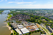 Nederland, Gelderland, West-Betuwe, 13-05-2019; Zaltbommel. bedrijventerrein aan de Gamerschedijk, westkant van de stad. Zicht op het centrum en rivier de Waal.<br /> Zaltbommel. Industrial estate, west side of the city. View of the city center and the river Waal.<br /> <br /> luchtfoto (toeslag op standard tarieven);<br /> aerial photo (additional fee required);<br /> copyright foto/photo Siebe Swart