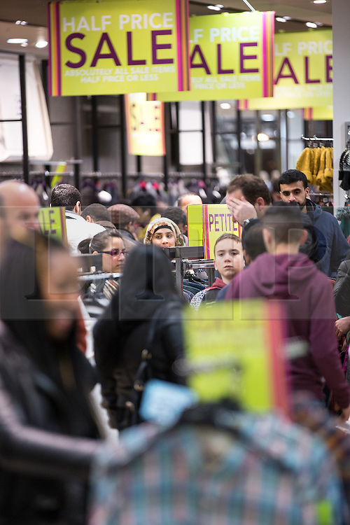 © Licensed to London News Pictures . 26/12/2013 . Manchester , UK . Shoppers inside Next . Queues for Next in Manchester's Arndale Centre stretch around the block , ahead of a 6am opening . Thousands of shoppers queue for hours in freezing temperatures in Manchester this Boxing Day morning (26th December 2013) in order to be amongst the first to purchase reduced price products in shops' sales . Photo credit : Joel Goodman/LNP
