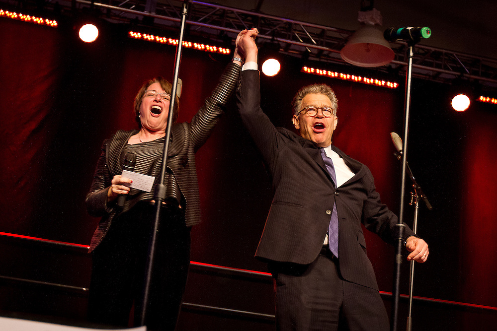 Sen. Amy Klobuchar (D-Minn.) and Sen. Al Franken (D-Minn.) celebrate onstage during Minneapolis Mayor Betsy Hodges' inauguration party at the historic Thorp Building in Northeast Minneapolis, Saturday, January 11, 2014.