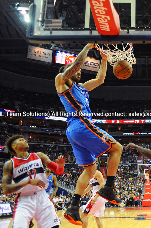10 November 2015:  Oklahoma City Thunder center Steven Adams (12) dunks the ball against Washington Wizards forward Kelly Oubre Jr. (12) at the Verizon Center in Washington, D.C. where the Oklahoma City Thunder defeated the Washington Wizards, 125-101. (Photograph by Icon Sportswire)