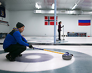 Jeff Pulli helps teammates line up a shot during a match at Rochester Curling Club on Sunday, February 8, 2015.