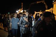 ITALY, Augusta - Immigrants are seen in the port of Augusta (Sicily) after they desembarked from an italian Coast Guard ship who rescued them at sea. on June 16, 2014. A new immigration wave is investing the italian region of Sicily.<br /> <br /> Augusta, Italia - 16 giugno 2014. Circa 400 immigrati sono stati tratti in salvo da alcune unit&agrave; della Capitaneria di Porto nell'ambito dell'operazione Mare Nostrum. I migranti sono sbarcati nel porto di Augusta in Sicilia. Da circa un mese gli sbarchi si susseguono quotidianamente.<br /> Ph. Roberto Salomone