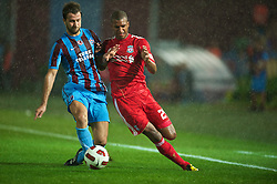 TRABZON, TURKEY - Thursday, August 26, 2010: Liverpool's David Ngog and Trabzonspor's Remzi Giray Kacar during the UEFA Europa League Play-Off 2nd Leg match at the Huseyin Avni Aker Stadium. (Pic by: David Rawcliffe/Propaganda)
