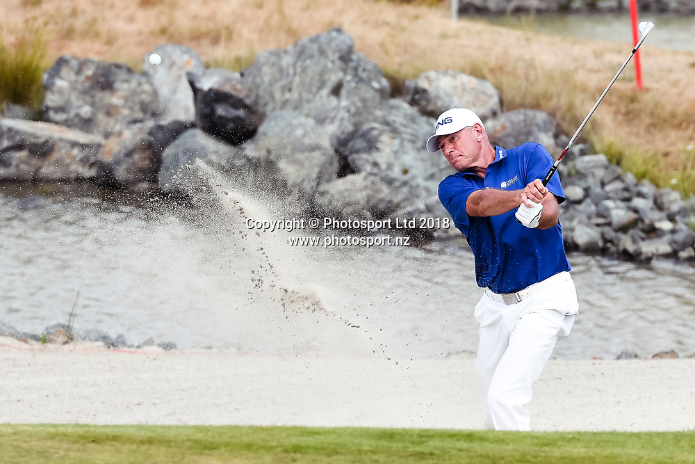 Peter Fowler (NSW) hits the ball from out of a sand bunker on the 18th hole.<br /> NZ Rebel Sports Masters, Wainui Golf Club, Wainui, Auckland, New Zealand. 14 January 2018. &copy; Copyright Image: Marc Shannon / www.photosport.nz.