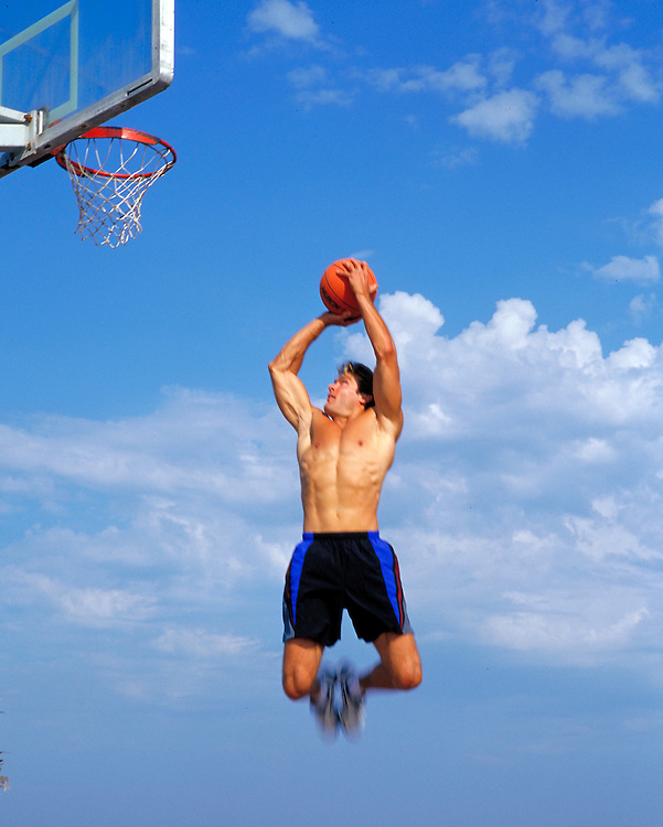 Young basketball player makes a jump shot