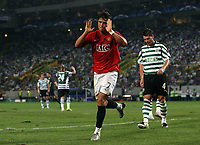 Photo: Paul Thomas.<br /> Sporting Lisbon v Manchester United. UEFA Champions League Group F. 19/09/2007.<br /> <br /> Cristiano Ronaldo of Utd scores and then says sorry to the Sporting fans.