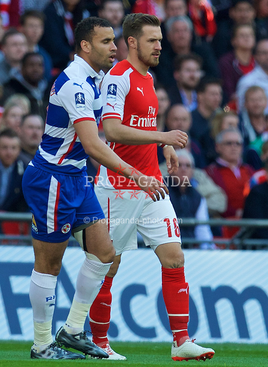 LONDON, ENGLAND - Saturday, April 18, 2015: Arsenal's Aaron Ramsey and Reading's Hal Robson-Kanu during the FA Cup Semi-Final match at Wembley Stadium. (Pic by David Rawcliffe/Propaganda)