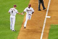 May 19 2011; Phoenix, AZ, USA; Arizona Diamondbacks batter Chris Young (24) is congratulated by third base coach Matt Williams (9) after hitting a one run home run during the sixth inning against the Atlanta Braves at Chase Field. Mandatory Credit: Jennifer Stewart-US PRESSWIRE
