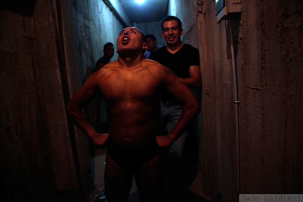A bodybuilder warms up before competing in a regional bodybuilding championship in La Paz, Saturday, April 10, 2010.