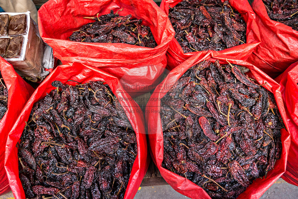 Dried red Gaujillo peppers at Benito Juarez market in Oaxaca, Mexico.